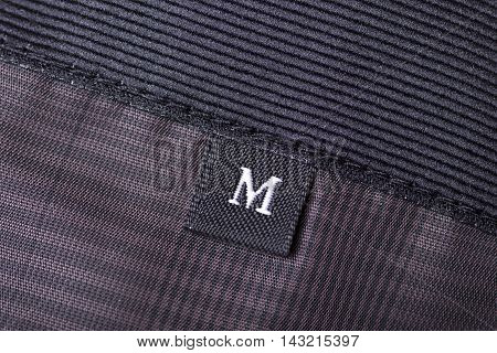 The tag size designation of clothes with the letter M