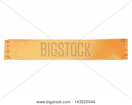 Blank orange clothes silk label - isolated on white background