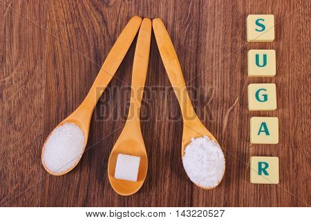 Sugar Cube, Granulated And Powdered Sugar On Wooden Spoons