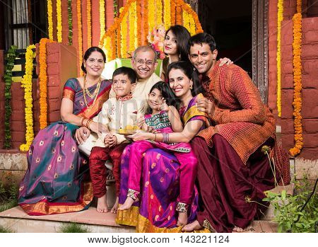 group photo of cheerful indian family in ganesh festival, happy indian family and ganpati festival