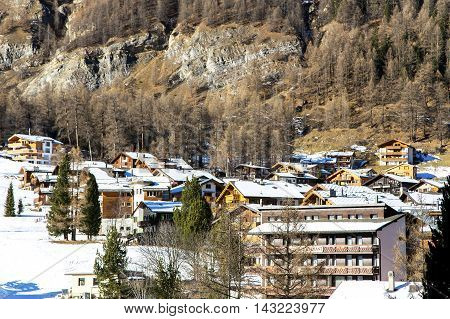 Beautiful winter landscape at mountain resort in Saas Fee near mount Valpelline, Switzerland.