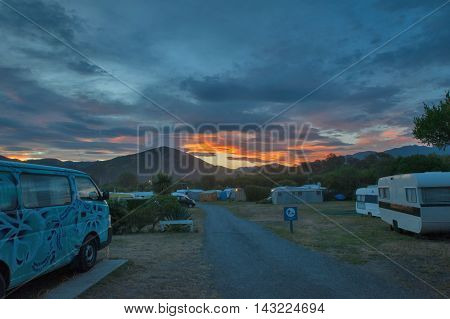 Motorhome park at Peketa Beach Kaikoura South Island of New Zealand during sunset