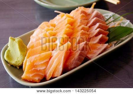 Japanese Sashimi salmon On the wooden table
