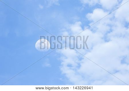 close up moon cloud in blue sky