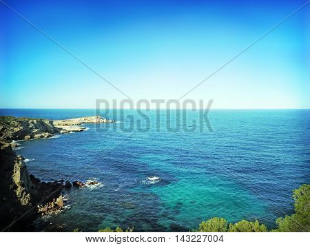 Coastline with view to turquoise sea and blue sky with copy space, nature background.