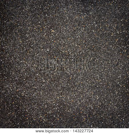 Backdrop of black stone wall texture for design pattern artwork.