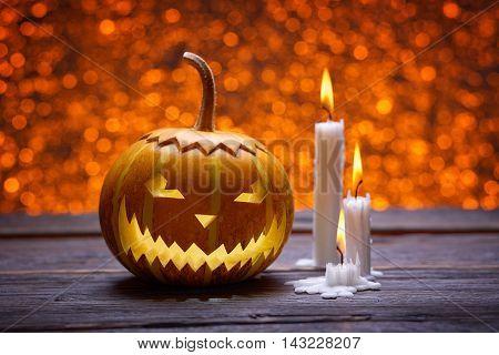 Pumpkin for Halloween, lamp pumpkin, antique wood, celebrating halloween, smiley on a pumpkin, paraffin candles, bright background, burning candles