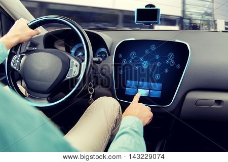 transport, road trip, technology, communication and people concept - close up of man driving car with network icons on board computer