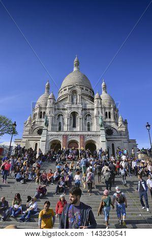 Paris, France - 20 April 2015: Tourists Visiting The Basilica Of The Sacred Heart Of Paris, A Roman