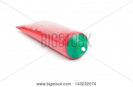a tube of cream on a white background
