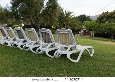 Deck Chairs On The Grass Holidays Summertime