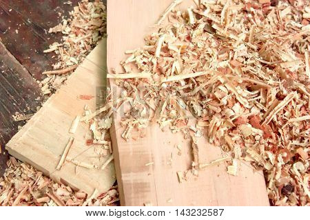 Old cabinet scraper spokeshave sapele exotic hardwood sawdust board chip shavings.