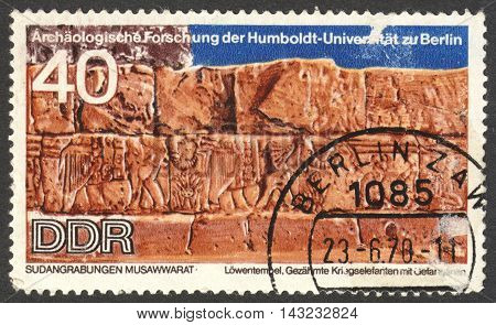 MOSCOW RUSSIA - CIRCA JUNE 2016: a post stamp printed in DDR shows War elephants carvings unearthed at Lions Temple the series
