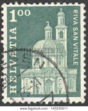 MOSCOW RUSSIA - CIRCA JUNE 2016: a post stamp printed in SWITZERLAND shows Santa Croce Church Riva San Vitale circa 1968