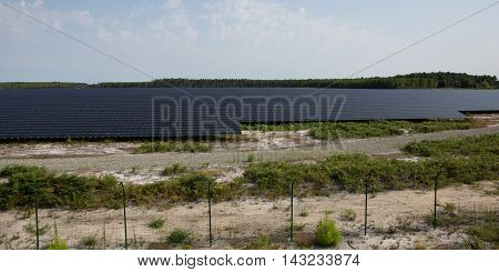 Photovoltaic Solar Panels Installation And A Sky
