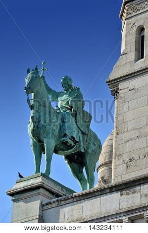 A Statue In Front Of The Basilica Of The Sacred Heart Of Paris, A Roman Catholic Church And Minor Ba