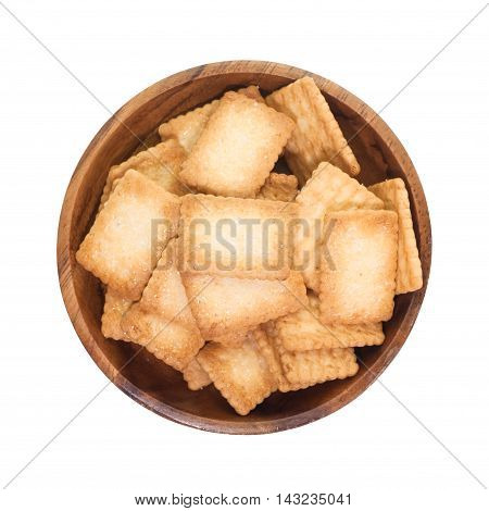 Mini coconut biscuit in wood plate isolated on white background
