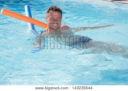 Portrait Of A Handsome And Happy Mid Aged Man Relaxing