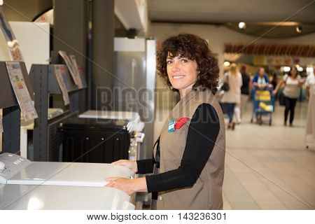 Positive Sales Assistant Portrait In Home Appliance Shop Supermarket