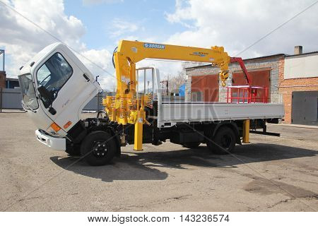 KEMEROVO RUSSIA - MAY 14 2015: White Truck crane standing on a construction site