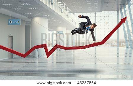 Optimistic dancing businessman . Mixed media