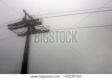 cable way in deep mist on white background