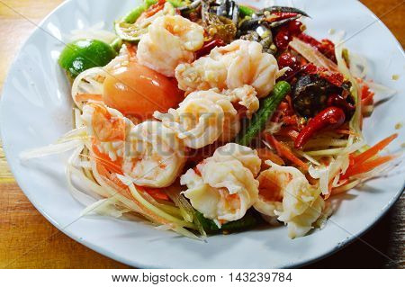 papaya salad and pickled crab in Thai called Som tum