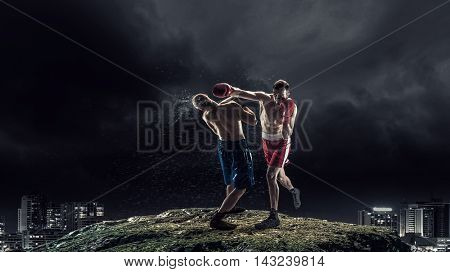 Box fighters trainning outdoor . Mixed media