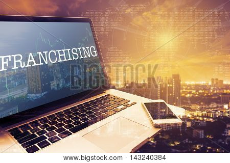 FRANCHISING : Grey screen laptop computer. Vintage effects. Digital Business and Technology Concept.