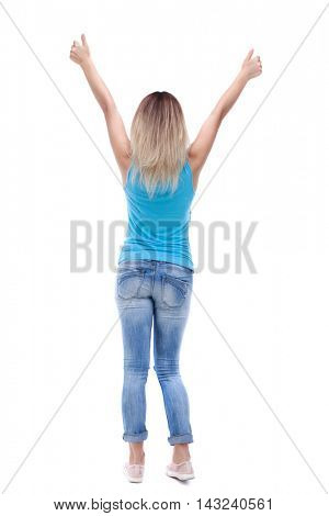 Back view of  woman thumbs up. Rear view people collection. backside view of person. Isolated over white background. The blonde in a blue shirt and jeans showing thumbs up with both hands.