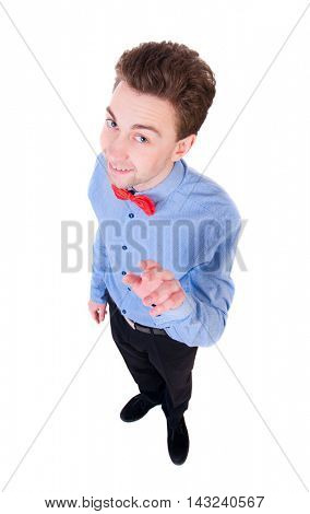 Smiling businessman in a bow tie looking up. top view. Isolated on white background. Satisfied businessman shakes his finger.