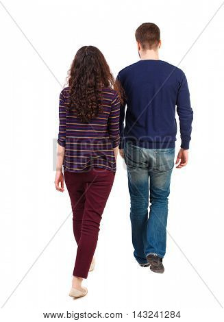 Back view going couple. walking friendly girl and guy holding hands. Rear view people collection. backside view of person. Isolated over white background. Swarthy girl and the bearded man into the
