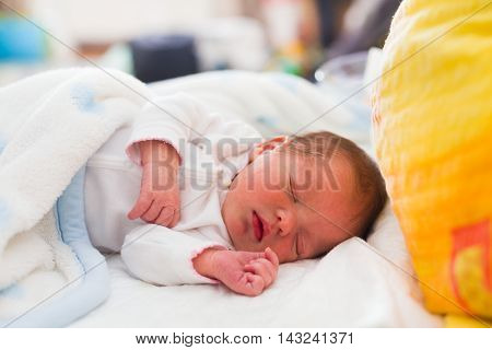 Little beautiful baby sleeping in bed alone.