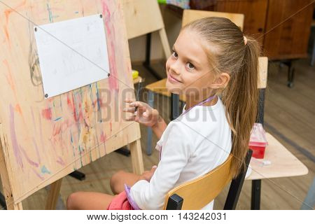Girl Happily Looks At The Teacher At A Drawing Lesson
