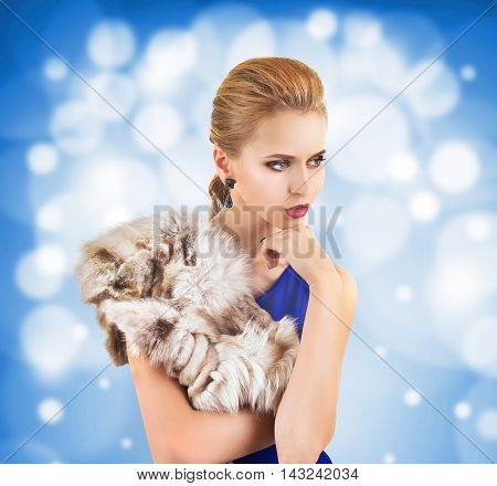 Elegant woman in fur cape on color background. Luxury lifestyle.