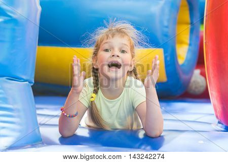 Happy Girl Lying On A Big Inflatable Trampoline Game