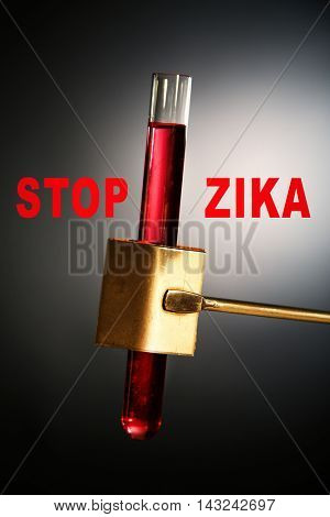 Zika virus danger concept. Text stop zika with blood sample in test tube, closeup.
