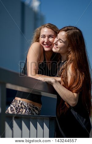 girlfriend in the arms go and laugh