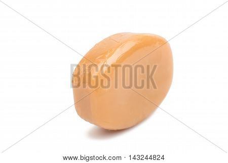 milk caramel  small candies isolated on white