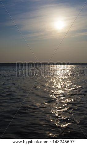 Sun rising over a large lake in Saskatchewan Canada