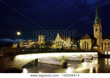 Night photo of Fraumunster Church and bridge over Limmat River, city of Zurich, Switzerland