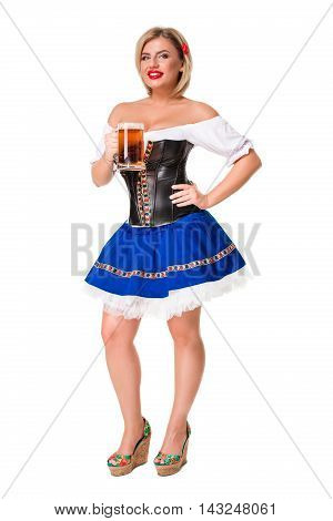 Beautiful young blond girl in dirndl drinks out of oktoberfest beer stein. Isolated on white background. full height