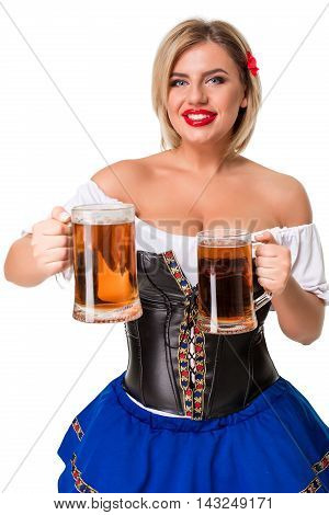 Beautiful young blond girl in dirndl drinks out of oktoberfest beer stein. Isolated on white background.