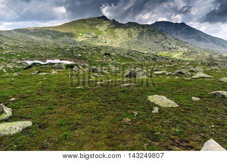 Dark clouds over Spanopolski chukar peak, Pirin Mountain, Bulgaria