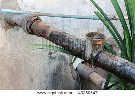 Water valve Plumbing Steel dilapidated. old rusty industrial tap water pipe. Dirty drinking water pipeline
