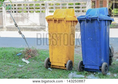 Dustbins in the colors blue yellow. recycling of large bins for rubbish.