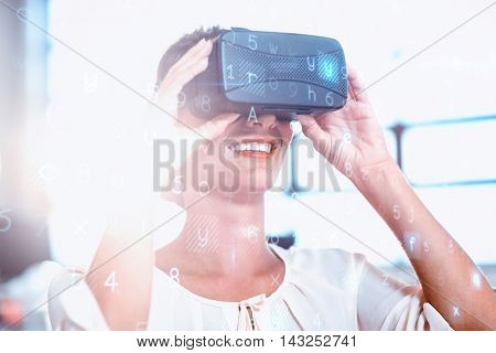 Young woman using the virtual reality headset at office