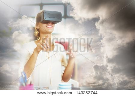 Female graphic designer using the virtual reality headset at office