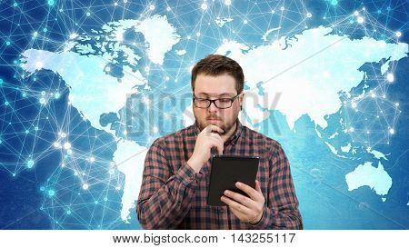 Hipster guy with tablet device . Mixed media
