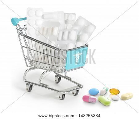 medicines in a shopping cart isolated on white